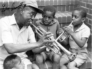 1987.14.1570 louis on steps bw 300x226 - Louis Armstrong Collection Now Digitized
