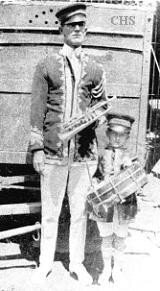 Christy Bros. Circus bandleader Everett James shown in 1922 with his son Harry James.