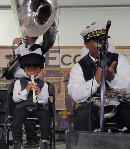 """Treme Brass Band – The """"Future of Fest"""" – toddler Kingston Wiley on recorder and his dad, Cedric, on saxophone. (photo by Ken Arnold)"""